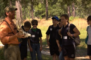Staff Biologist Beau Bauer conducts an educational program for area students.